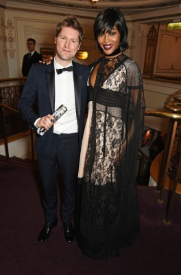 LONDON, ENGLAND - NOVEMBER 23: Christopher Bailey, winner of the Creative Campaign award for Burberry, and presenter Naomi Campbell attend the British Fashion Awards in partnership with Swarovski at the London Coliseum on November 23, 2015 in London, England. (Photo by David M. Benett/Dave Benett/Getty Images)